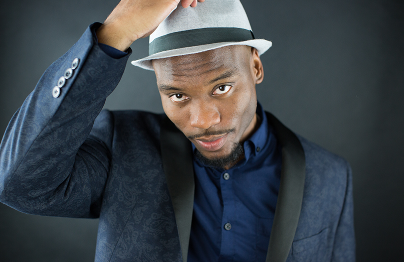 image of guy in fedora hat and suit jacket in professional photo studio